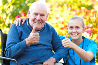 Elderly and caregiver with their thumbs up