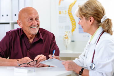 elderly man and doctor talking