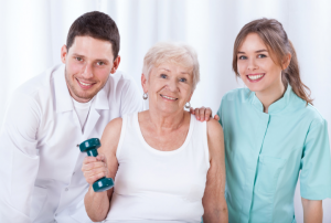 doctor, nurse and elderly woman smiling