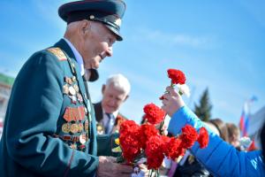 elderly man with flowers